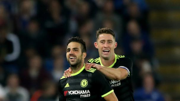 Cesc Fabregas (left) celebrates his second and Chelsea's fourth in their 4-2 extra time EFL Cup win at Leicester on Tuesday.