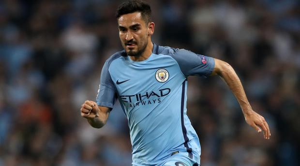 Ilkay Gundogan, pictured, is relishing the chance to play alongside Sergio Aguero