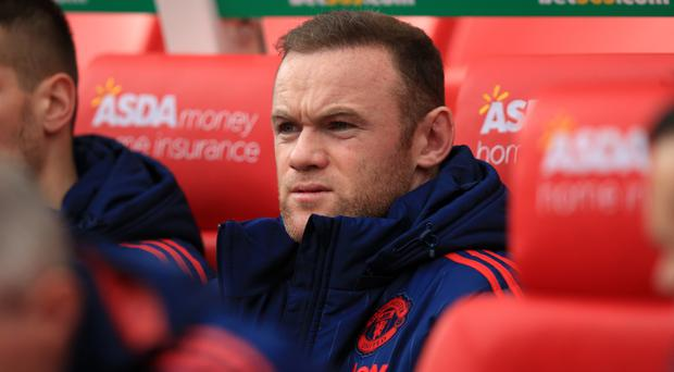Manchester United's Wayne Rooney will start Saturday's game on the bench