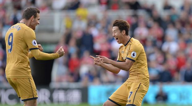 Tottenham's Son Heung-min (right) celebrates his first goal with Vincent Janssen.