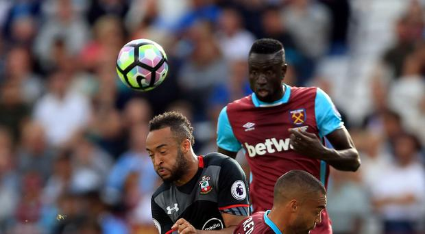 Winston Reid (front right) struggled as West Ham were thumped 3-0 by Southampton