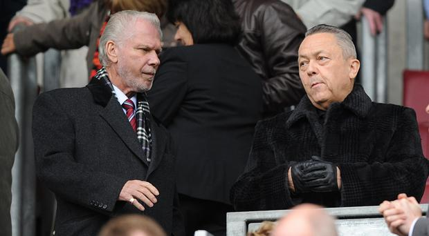 West Ham owners David Sullivan, right, and David Gold say they are doing everything they can to fix the club's problems