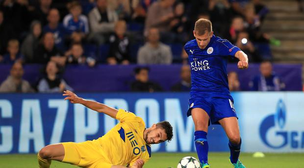 Leicester's Marc Albrighton (right) beats Porto's Alex Telles in the Foxes' 1-0 win on Tuesday.