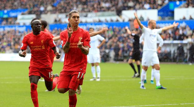 Roberto Firmino was on target as Liverpool came from behind to beat Swansea 2-1