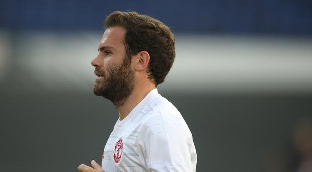 Juan Mata took time out before training to delight a young Manchester United fan