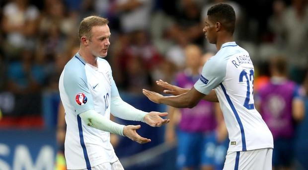 Marcus Rashford, right, has earned the praise of his captain Wayne Rooney