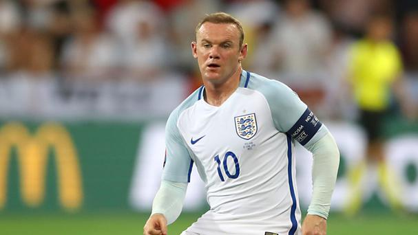 Wayne Rooney has urged England to stick together after a 'tough' week