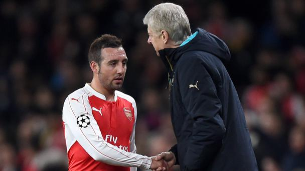Midfielder Santi Cazorla (left) sees no reason why manager Arsene Wenger would make this season his last in charge at Arsenal