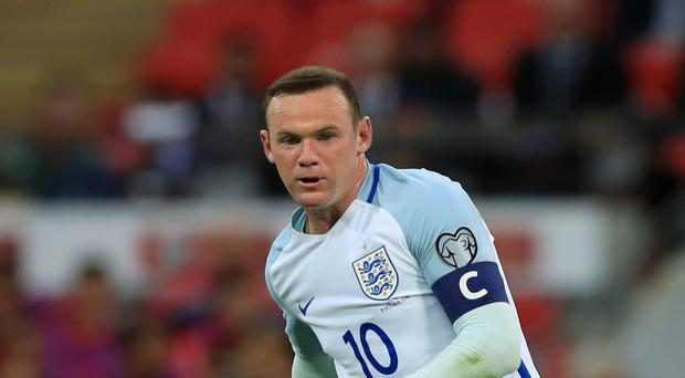 Wayne Rooney is set to be dropped to the bench for England's World Cup qualifier away to Slovenia on Tuesday
