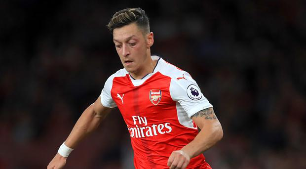 Arsenal midfielder Mesut Ozil has played down injury worries following international duty with Germany