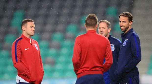 Gareth Southgate (right) omitted Wayne Rooney (left) from England's starting line-up for the 0-0 draw in Slovenia.