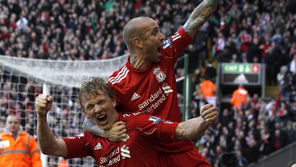 Liverpool's Dirk Kuyt (left) celebrates his hat-trick against Manchester United with Raul Meireles (right).