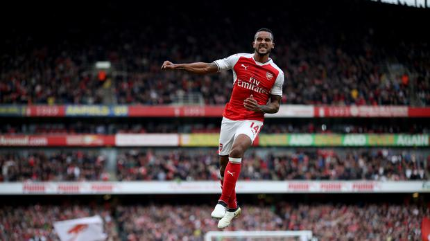 Theo Walcott celebrates scoring his second goal against Swansea