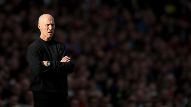 Bob Bradley on the touchline at Arsenal