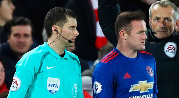 Coming on: Wayne Rooney enters the fray against Liverpool after being kept on the bench