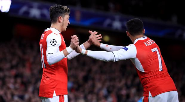 Mesut Ozil, left, and Alexis Sanchez were among the goals on Wednesday