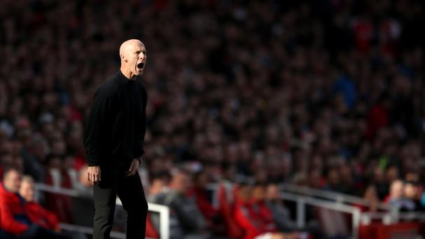 New Swansea boss Bob Bradley, pictured, will lose his black jumper following criticism from Gary Lineker