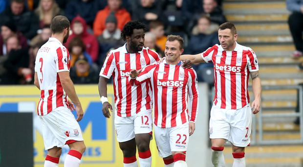 Xherdan Shaqiri, second right, celebrates his second goal at Hull