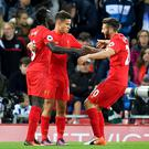 Adam Lallana joins Liverpool goalscorers Philippe Coutinho, centre, and Sadio Mane, left, to celebrate