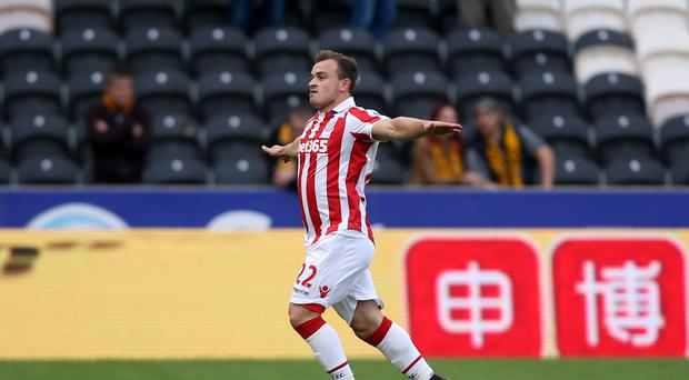 Xherdan Shaqiri celebrates his opening goal at the KCOM Stadium