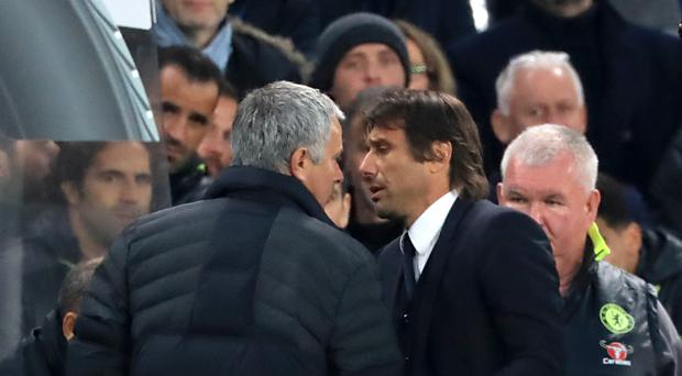 Manchester United manager Jose Mourinho and Chelsea manager Antonio Conte exchange words at the end of Sunday's Premier League match