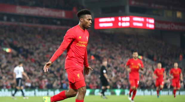 Daniel Sturridge celebrates the first of his two goals