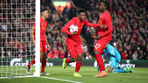Daniel Sturridge, centre, scored twice to send Liverpool through