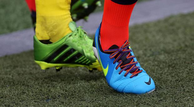 Football clubs lower down the pyramid could benefit from signing an openly gay player, according to a football finance expert.