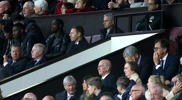 Jose Mourinho, centre top, spent the second half in the directors' box