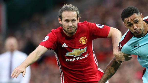 Daley Blind, left, cannot believe Manchester United failed to beat Burnley