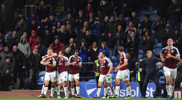 Burnley's Ashley Barnes celebrates scoring his side's third goal of the game during the Premier League match at Turf Moor, Burnley.