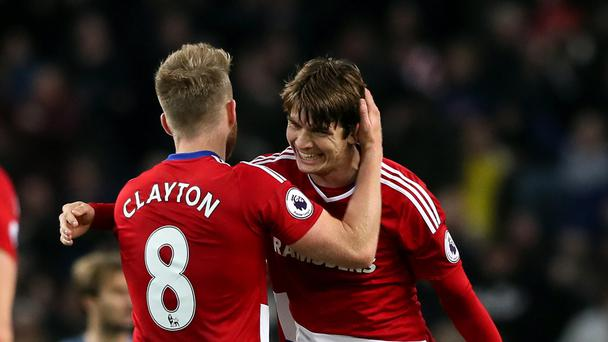 Marten de Roon (right) celebrates his late goal