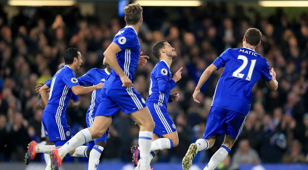 Eden Hazard, second right, celebrates his second goal