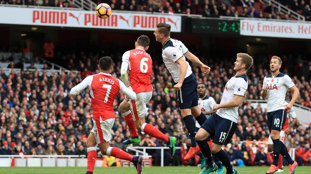 Spurs' Kevin Wimmer, centre right, heads into his own net