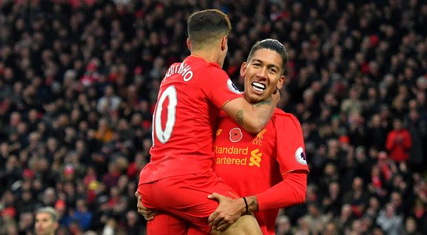 Philippe Coutinho, left, and Roberto Firmino were both in the goals