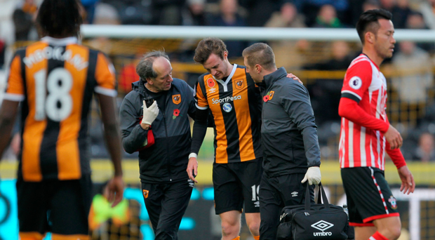 Hull City's Will Keane (centre) leaves the pitch an injury during the Premier League match at the KCOM Stadium, Hull.