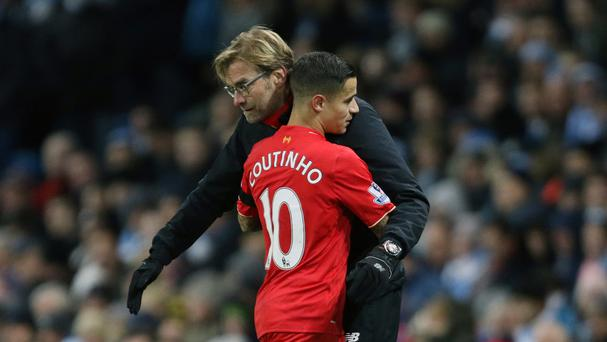 Liverpool manager Jurgen Klopp is confident playmaker Philippe Coutinho is happy at the club