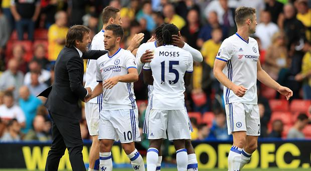 Chelsea head coach Antonio Conte (left) says Eden Hazard (second left) is thriving because he is putting the team first