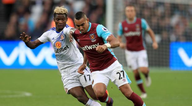 Dimitri Payet (right) and West Ham take on Tottenham on Saturday.