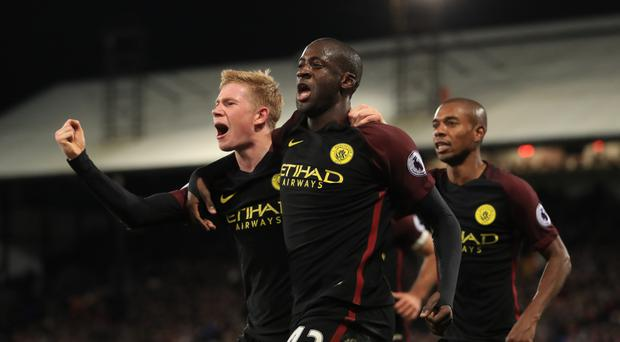Yaya Toure's two goals secured Manchester City's 2-1 victory at Crystal Palace