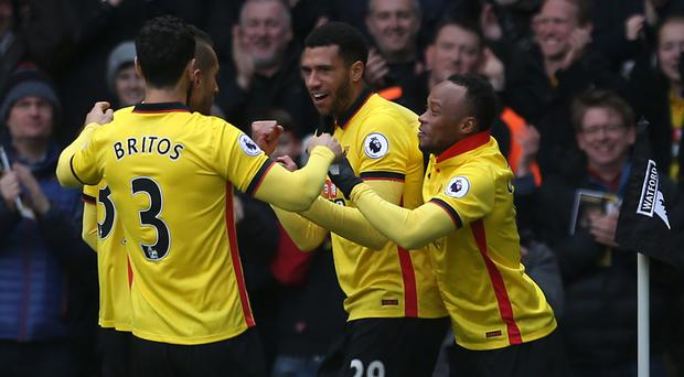 Watford's Etienne Capoue (centre) celebrates scoring his side's first goal