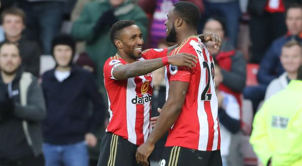 Sunderland's Jermain Defoe (left) celebrates scoring his side's first goal of the game with team-mate Victor Anichebe, who went on to score two himself