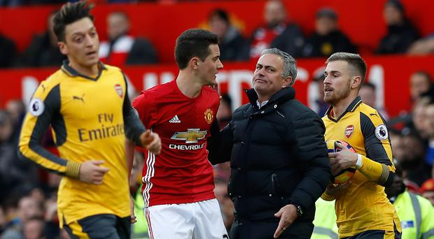 Manchester United manager Jose Mourinho (centre) was left less than impressed after his side were not awarded a penalty in the 1-1 Premier League draw with Arsenal at Old Trafford