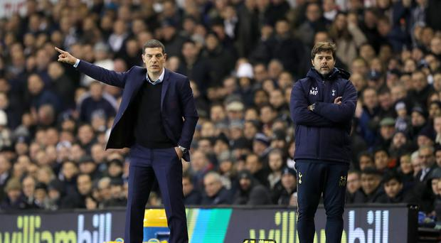 Slaven Bilic, left, saw his West Ham side beaten by Tottenham last weekend