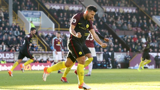 Sergio Aguero scored twice to help Manchester City beat Burnley 2-1 at Turf Moor
