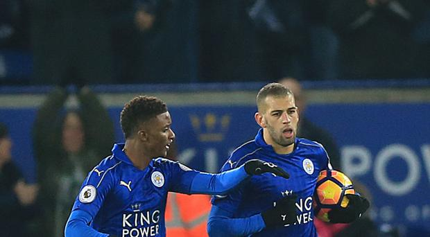 Leicester striker Islam Slimani (right) celebrates his late penalty against Middlesbrough
