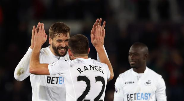 Fernando Llorente, pictured left, netted a dramatic late winner for Swansea against Crystal Palace