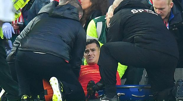 Liverpool's Philippe Coutinho is set for a scan on Monday