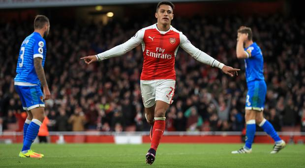 Alexis Sanchez scored twice to lift Arsenal to victory over Bournemouth