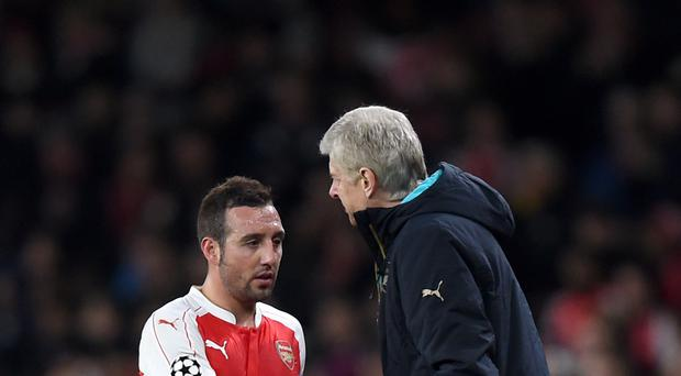 Arsene Wenger, pictured right, confirmed Santi Cazorla will miss up to three months following ankle surgery